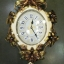 นาฬิกาแขวนผนังดีไซน์สวยหรู ประดับขอบตัวเรือนด้วยดอกไม้สีทอง thumbnail 1